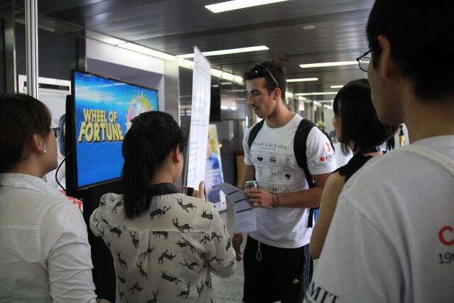 RMIT-student-played-game-at-TRG-information-booth.jpg